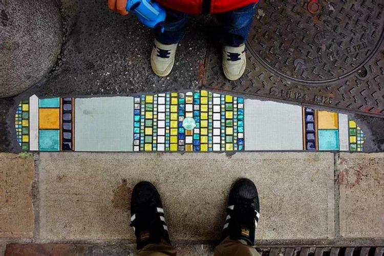 Artist Fixes Cracked Sidewalks and Potholes With Mosaics